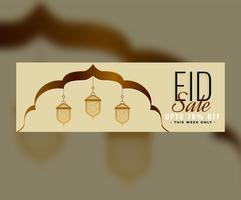 Diseño de banner de venta eid con linterna decorativa islámica.