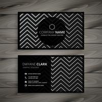 design de cartão de visita escuro com formas de linha em zigue-zague