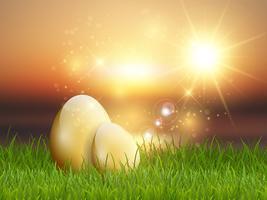 Oeufs de Pâques dorés dans l'herbe