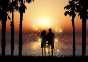 De holdingshanden van het paar tegen een zonsondergangachtergrond
