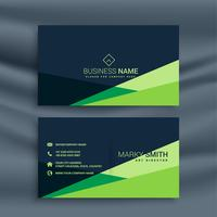 dark business card with green geometric shape