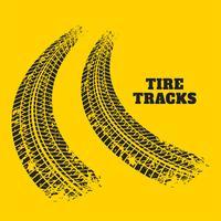 impronte di pneumatici stradali su sfondo giallo