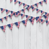 Flag bunting on wooden background