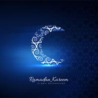 Beautiful card ramadan kareem with shiny moon blue background