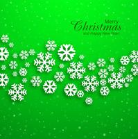 Merry christmas greeting card snowflakes green background