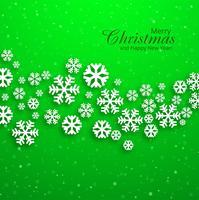 Fondo verde de los copos de nieve de la tarjeta de felicitación de la Feliz Navidad