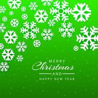 Tarjeta de felicitación de Navidad feliz fondo de copos de nieve verde