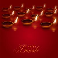 burning diya lamps placed on red background for diwali festival
