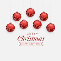 Feliz Navidad saludo diseño con bolas rojas colgantes