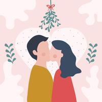Pareja besándose bajo el muérdago Vector
