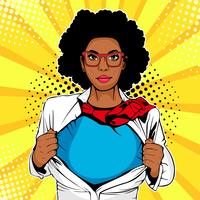 Pop art female afro american superhero. Young sexy woman dressed in white jacket shows superhero t-shirt. Vector illustration in retro pop art comic style.
