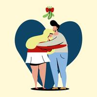 couple standing under mistletoe
