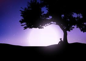 Niño sentado contra un árbol contra un cielo nocturno
