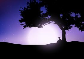 Boy sitting against a tree against a night sky
