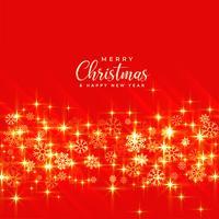 brilhos de Natal dourado brilhante sobre fundo vermelho