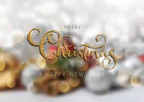 Glittery Christmas text on a defocussed background