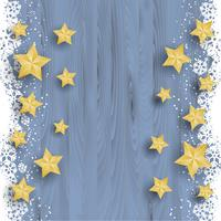 Christmas stars on snowy wood background
