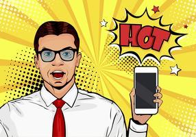Attraktiv leende man med telefon i handen i komisk stil. Popkonst vektor illustration i retro komisk stil. Digital reklam manlig modell som visar meddelandet eller ny app på mobilen