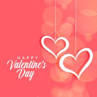 hanging hearts on pink bokeh background for valentines day