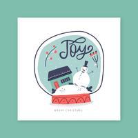Bola de nieve con muñeco de nieve dentro con tarjeta de casa