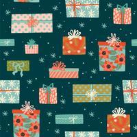 Navidad y feliz año nuevo de patrones sin fisuras con cajas de regalo.