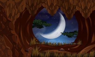 Grotta på natten med månens scen