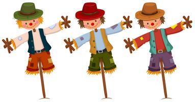 Three scarecrows on wooden sticks