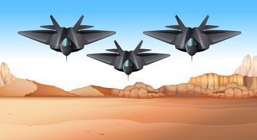 Tre stridsflygplan som flyger över öknen