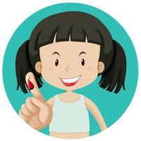 En flicka som blöder på fingeren