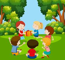 Children play pass the parcel