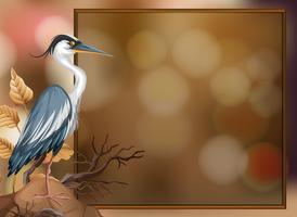 Un oiseau grue sur fond flou