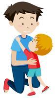 Papa umarmt seinen Sohn