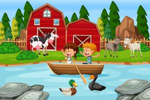 Children paddle wooden boat at farm