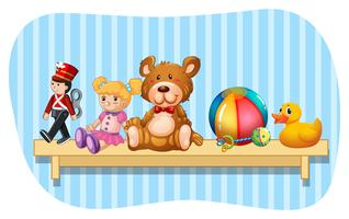 Many types of toys on wooden shelf