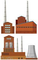 Fábrica de edificios con chimeneas altas.