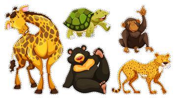 Conjunto de pegatinas con muchos animales salvajes.