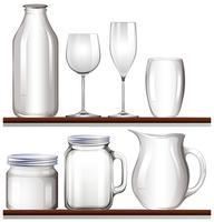 Vasos y botellas en estantes de madera.