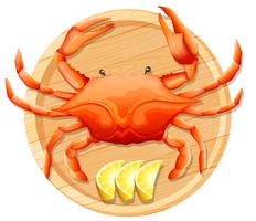 A crab on wooden plate