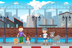 Boy walking dog in town