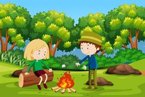 Boy and girl camping at forest