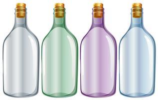 Cuatro botellas de vidrio