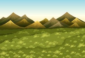 Escena de fondo con campo y montañas