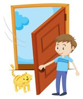 Man open the door for pet cat