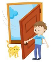 Hombre abre la puerta para gato mascota