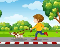 menino andando com um cachorro