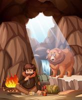 Un hombre acampando en la cueva del oso.