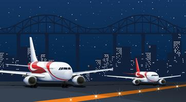 Two airplanes on runway