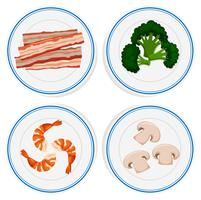 Vier soorten ingrediënten op witte platen