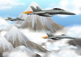 Three jet planes flying over the mountains