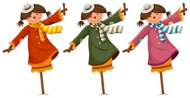 Three scarecrows in woman clothes